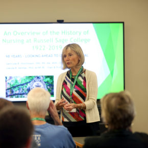 Glenda Kelman speaks to alumnae_i about the history of Russell Sage College's Nursing department.