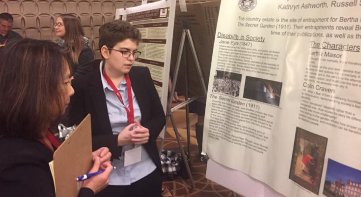 Kathryn presents research at the National Collegiate Honors Council conference in 2018.